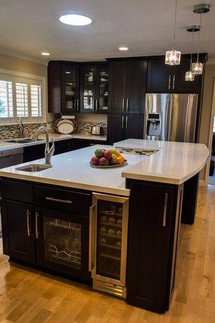 Modern Kitchen with Pendant light, Lbl rocks clear cube nickel pendant light, Wine refrigerator, Ceramic Tile, Crown molding