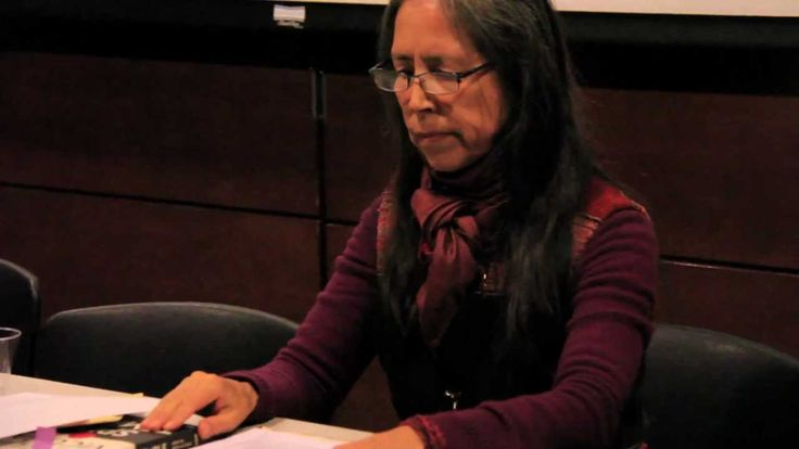 Cecilia Vicuña writing on peoples' hands