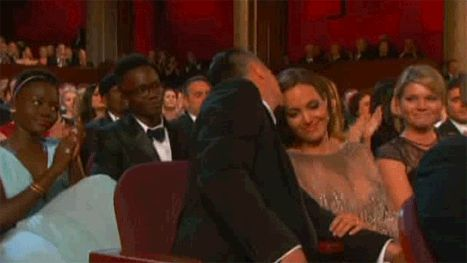 Angelina Jolie Gets Emotional, Kissed By Brad Pitt at Oscars: Video - Us Weekly