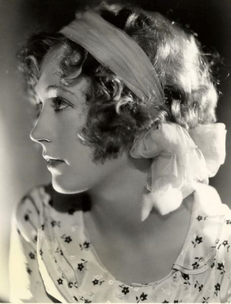 Marion Davies with curls and head scarf.