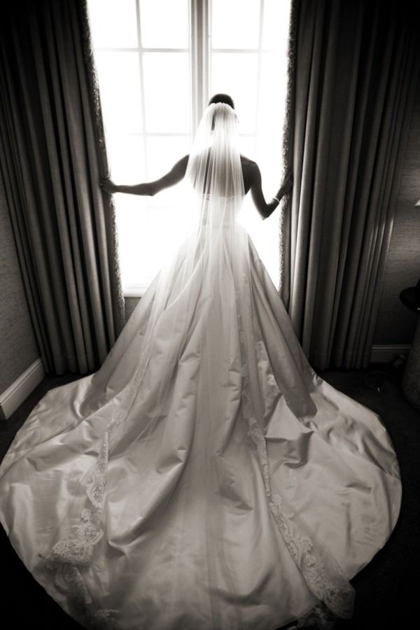 Love the veil and the big brutal dress.