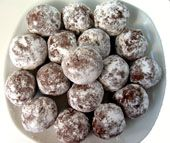 Rum balls are a rich, chocolately candy with a sophisticated taste that appeals to adults. This recipe for rum balls can also be used to make bourbon balls.