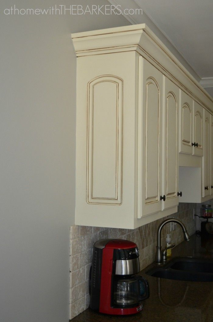DIY glazed kitchen cabinets.  Creamy cabinets with grey walls, love.