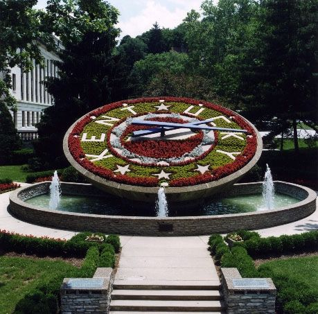 Kentucky's Floral Clock is located behind the Capitol in Frankfort, Kentucky. Resting over a pool of water, the giant clock is 34 feet across. It takes more than 10,000 plants to fill the clock. All are grown in the state's greenhouses near the Capitol. The coins that visitors throw in the pool are collected and used to benefit young people all across the state. (Check out Google Images to see the different planting schemes that have been used on the clock over the years.)