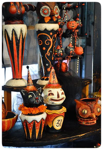 vintage Halloween.  I think some of these things could be recreated using things like, planters, styrofoam balls, paper mache, paints, glue guns....