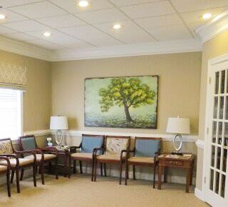 Wouldn't mind waiting in a waiting room like this! Local dentist office made over by Main Street Interiors.