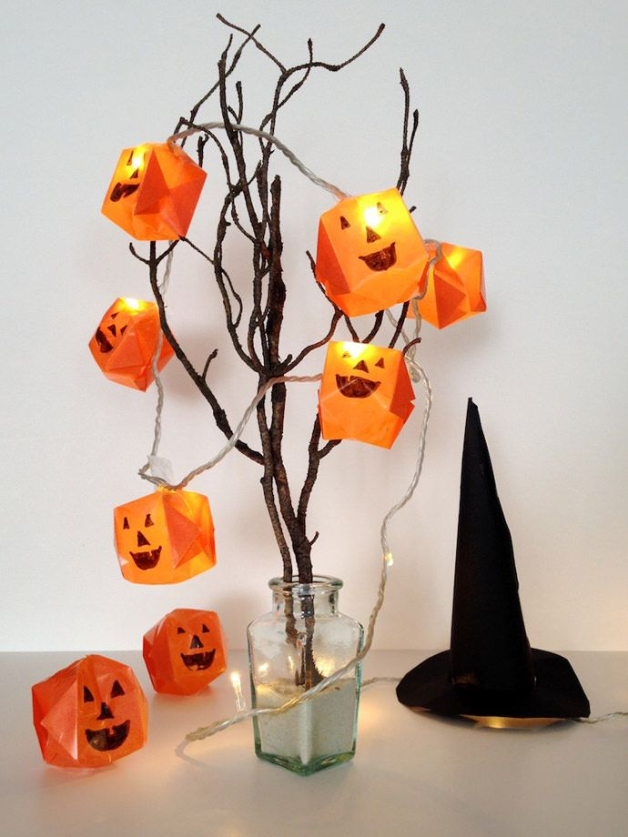 Make a string of spooky Halloween lights using origami jack-o-lanterns and ghosts!