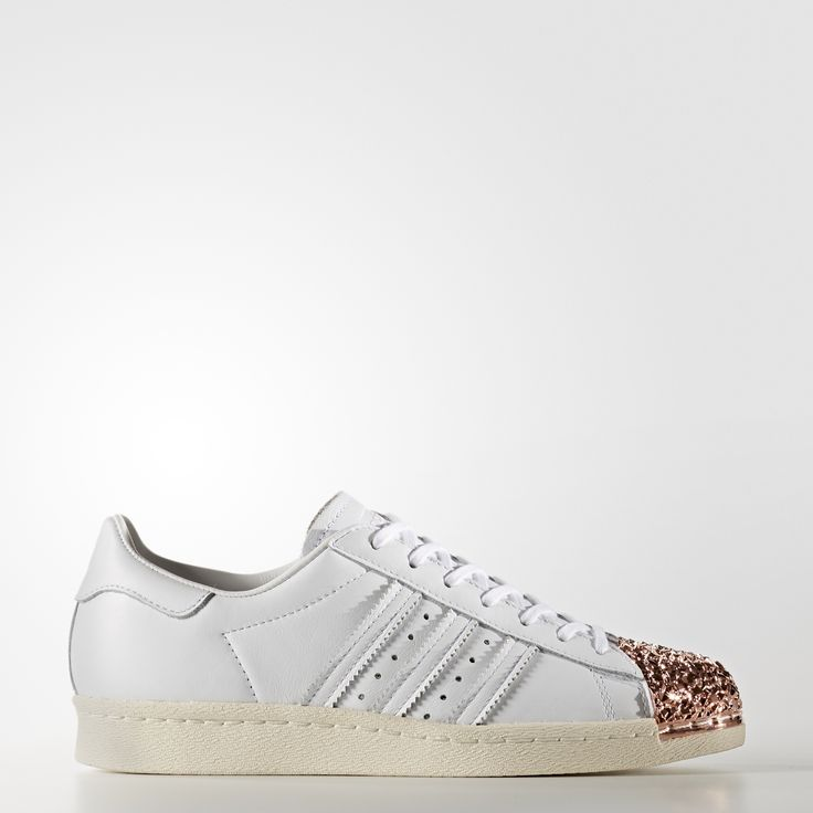Launched in 1970 as a revolutionary basketball performance style, the adidas Superstar shoe was the sport's first all-leather sneaker. In '80s New York City, hip-hop heroes lifted a pair up on stage and dedicated a song to them. A legend was born. As fresh as ever, this modern version of the adidas Superstar shoe features a 3D metal shell toe with the look of shattered glass. The women's shoes are built with an all-leather upper and finished with serrated 3-Stripes and a herringbo...