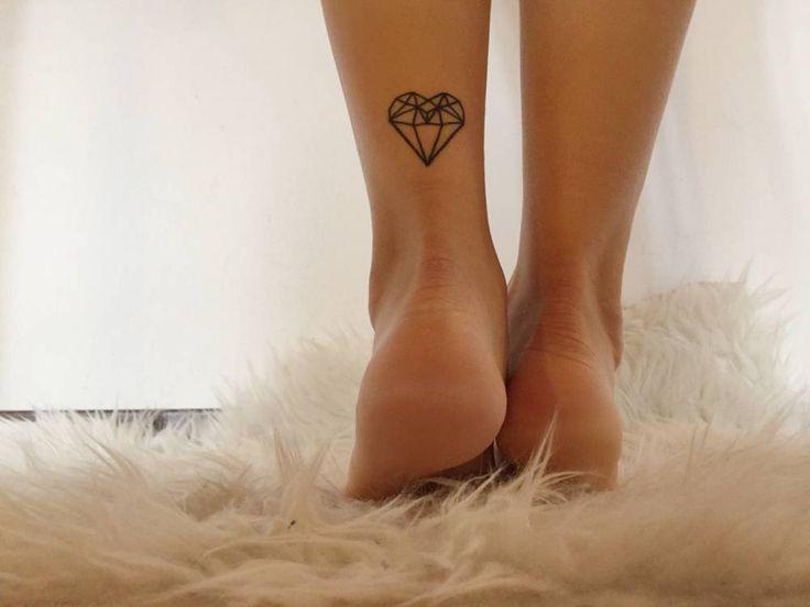 Polygon heart tattoo on Giulia Fabrizi.