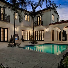 contrast colors, light house color with dark roof, windows    mediterranean pool by Torre Construction & Development
