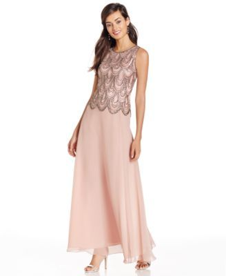 Make a stunning impression in this chiffon gown from J Kara, featuring an elegant beaded bodice. | Polyester; lining: polyester | Dry clean | Imported | High neckline | Back zipper with hook-and-eye c