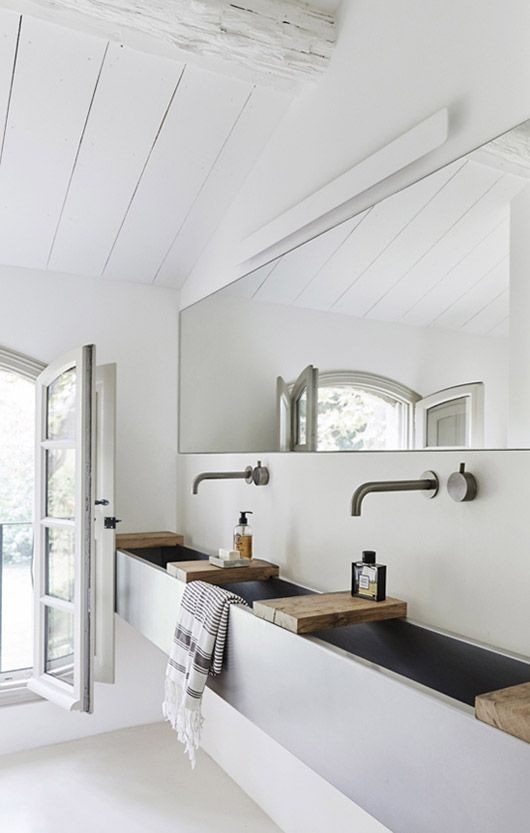 white bathroom walls with rustic modern sink. / sfgirlbybay
