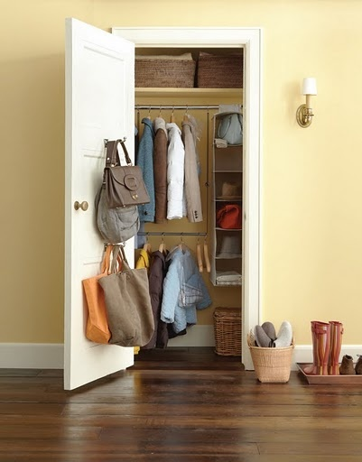 hang a closet rod extender to double the storage in the entryway coat closet or any closet really idea from martha stewart