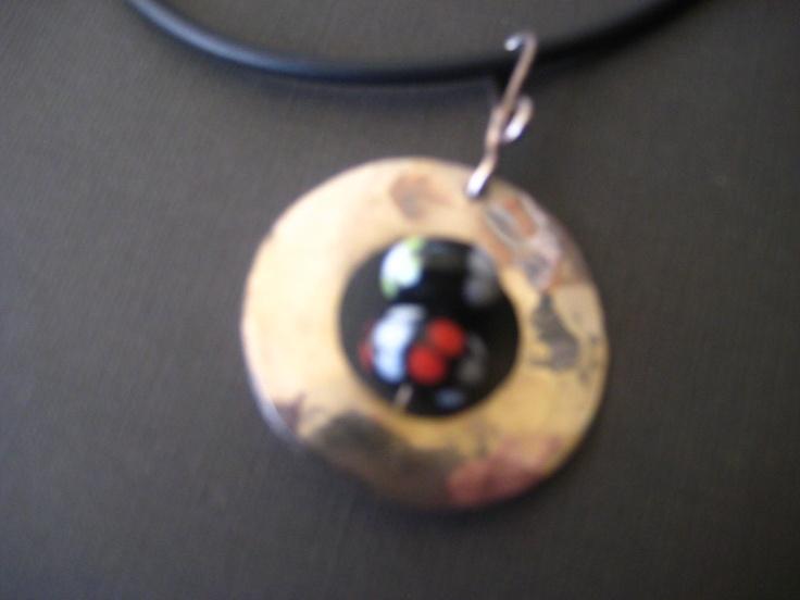 silver circle with handmade glasbeads