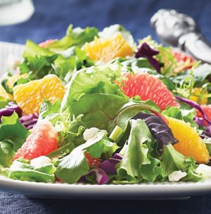 The best of winter's citrus bounty is showcased in this beautiful Feta-Citrus Salad. Ruby red grapefruit and oranges are tossed with fresh greens and salty feta cheese. The sweet and tart citrus vinaigrette makes it even more special.