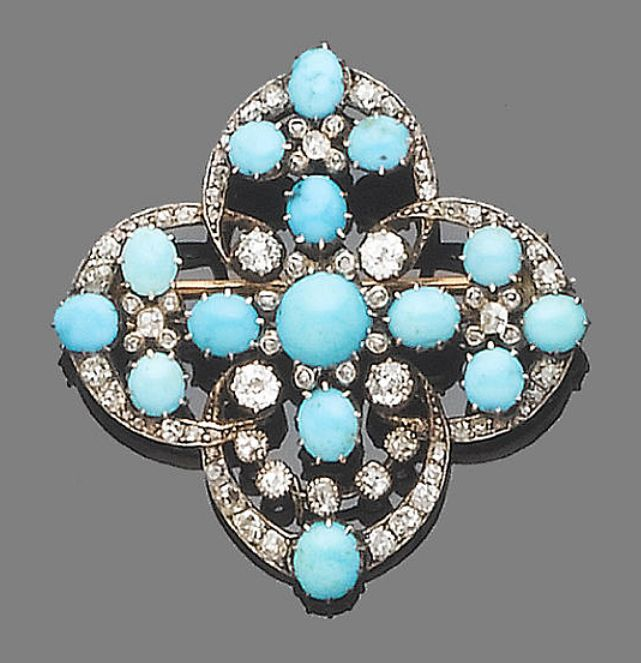 A turquoise and diamond brooch/pendant, circa 1890. The stylised flowerhead of openwork design, set throughout with old brilliant and rose-cut diamonds and cabochon turquoises, mounted in silver and gold, diamonds approx. 2.1ct. total, length 4.3cm.