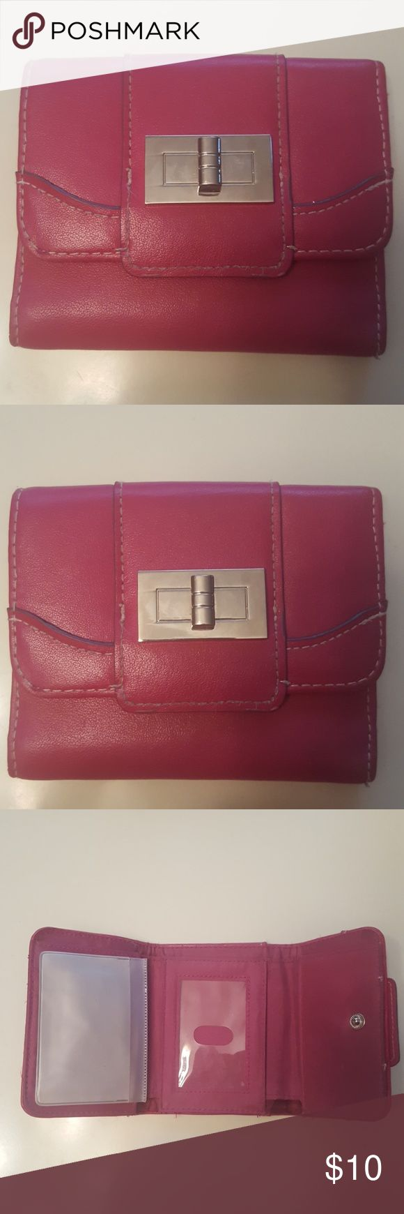 NWOT SMALL HOT PINK WALLET FROM DILLARDS THIS IS A NWOT SIZE SMALL WOMEN'S HOT PINK WALLET, IT IS A SNAP CLOSURE. OPENED UP HAS 5 SLOTS FOR CREDIT CARDS/ETC. A LONG POCKET FOR DOLLAR BILLS & 8 PLASTIC SLOTS FOR PHOTOS. A SLOT ON THE OUTSIDE BACK AS WELL. SILVER ACCESSORY ON THE FRONT. BOUGHT FROM DILLARDS FOR ABOUT $25 DOLLARS. PRICE IS FIRM, NO TRADES, 25% OFF TWO OR MORE OF MY LISTINGS. THANK YOU! dillards Bags Wallets
