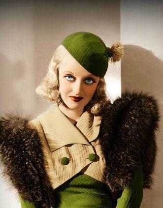 Bette Davis, looking glamorous in a stylish 30s-style ensemble.