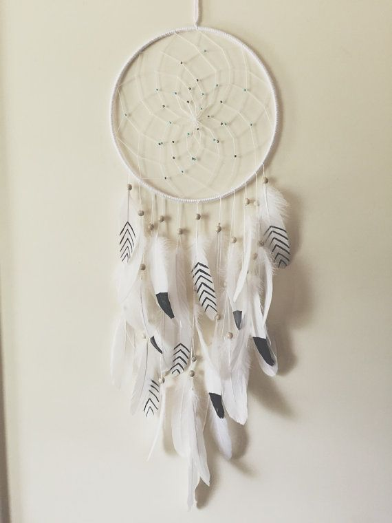 This dreamcatcher is amazing. It would look awesome above your bed on somewhere to show off as a statement piece. It is wrapped in white yarn and the
