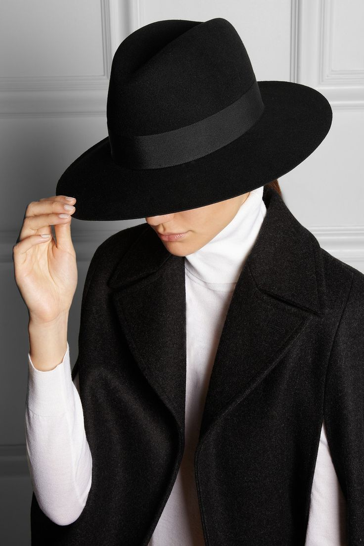 Fedoras don't come more sophisticated than Saint Laurent's black rabbit-felt style. Perfectly proportioned, this grosgrain-trimmed design is sure to suit all face shapes. Wear it with a tailored look.  Shown here with: Saint Laurent cape and top.
