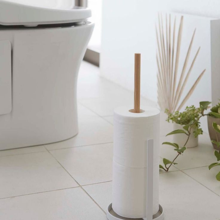 Wood accent toilet paper holder. Holds 3 rolls. Tosca Toilet Paper Holder #yamazakihome #yamazakitosca #tosca #scandinavian #toiletpaperholder #toiletpaperstand #toiletary #bathroom #interiordesign #homedecor