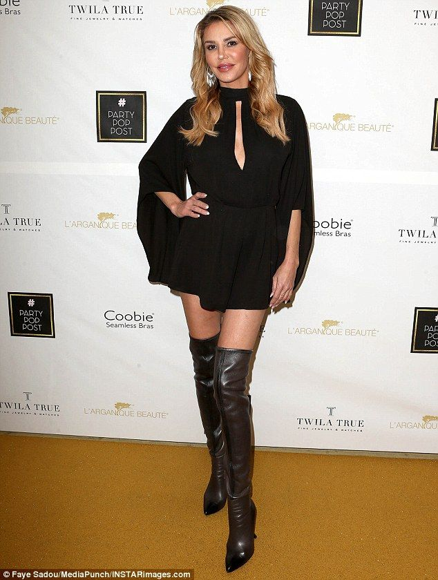 Legs for days! The Real Housewives Of Beverly Hills star, 44, put on a leggy display ina flirty black frock with keyhole cut out above the bust and thigh-high leather boots