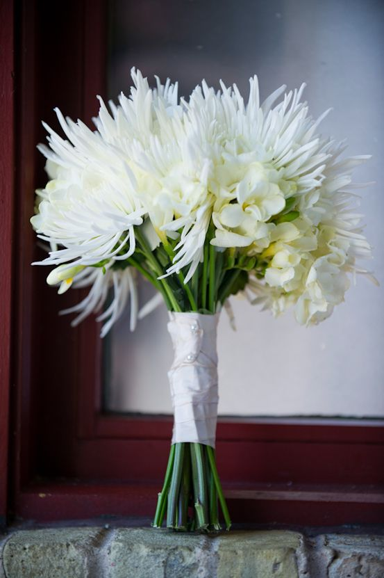 I like this with the white spider mums. Take out the other flowers and add lime spider mums