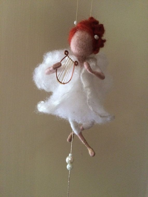 This can be a Christmas decoration, but it can also be a home decor that complements your home at any time, because our angels are always with us. This can be very elegant gift for any celebration.   Angel in white dress trimmed with silk, holding a lyre. This is one of my musical character. The dress is made in the form of a bell. His hair is decorated with natural pearls. The bell is made by me.  The height of the entire composition is 32 cm, height of angel is 12 cm.