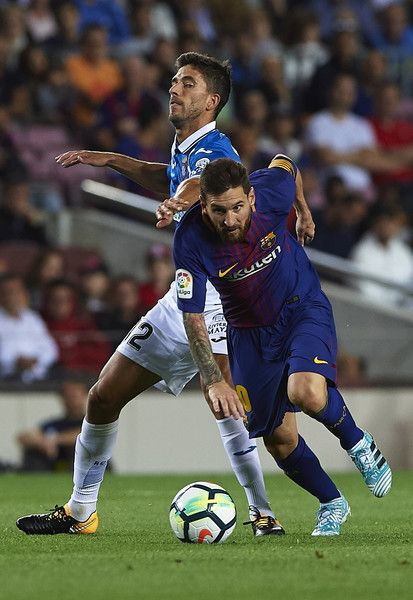 Lionel Messi (R) of Barcelona is tackled by Marc Navarro of Espanyol during the La Liga match between Barcelona and Espanyol at Camp Nou on September 9, 2017 in Barcelona.