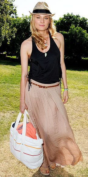 DIANE KRUGER  Where preppie meets hippie: The actress pairs a flowing maxi skirt and layered chains with a striped tote, Joie sandals and Panama hat at the Lacoste L!ve/HTC Coachella 2011 Pool Party in Thermal, Calif.