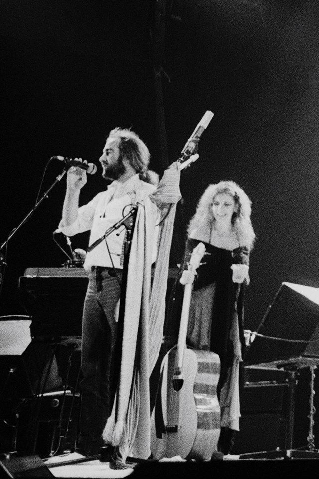 a rare photo of Stevie ~ ☆♥❤♥☆ ~ holding John McVie's bass while he says something on the microphone during a Fleetwood Mac rehearsal