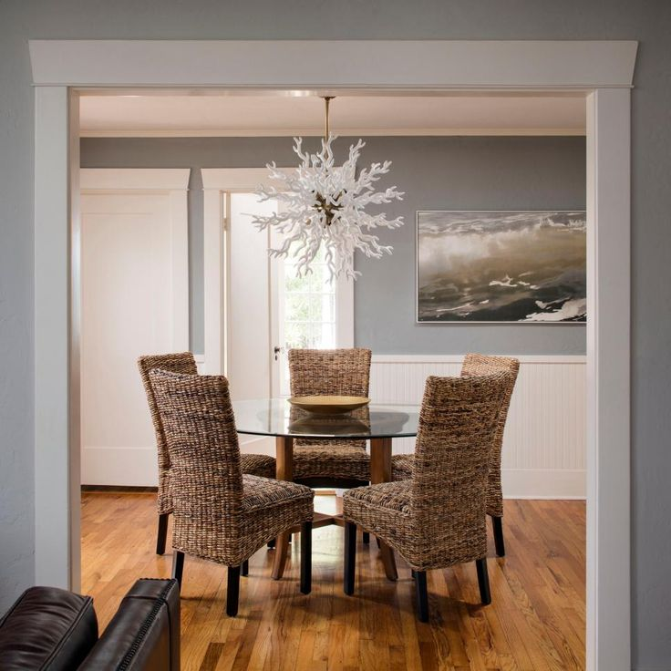 Wicker Chairs Are A Compelling Combination With The White Coral Like Light Fixture In This Dining Room Pale Gray Walls Help Textures And Crisp