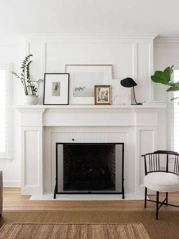 a white modern fireplace.