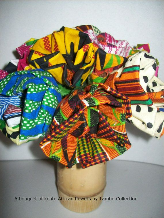 African fabric flowers just in time for any occasion, and can be used to brighten up your African room or for any occasion. These will never fade. Hand made by Tambo Collection from 100% African kente fabrics. Made from left over end fabrics, recycled wax prints and other tribal prints. Seen pictured in an assortment of 12.  *Priced as each flower.  Get yours today for Black History Month celebration, Valentines, Special Occasions, African decoration, African crafts, weddings and more…