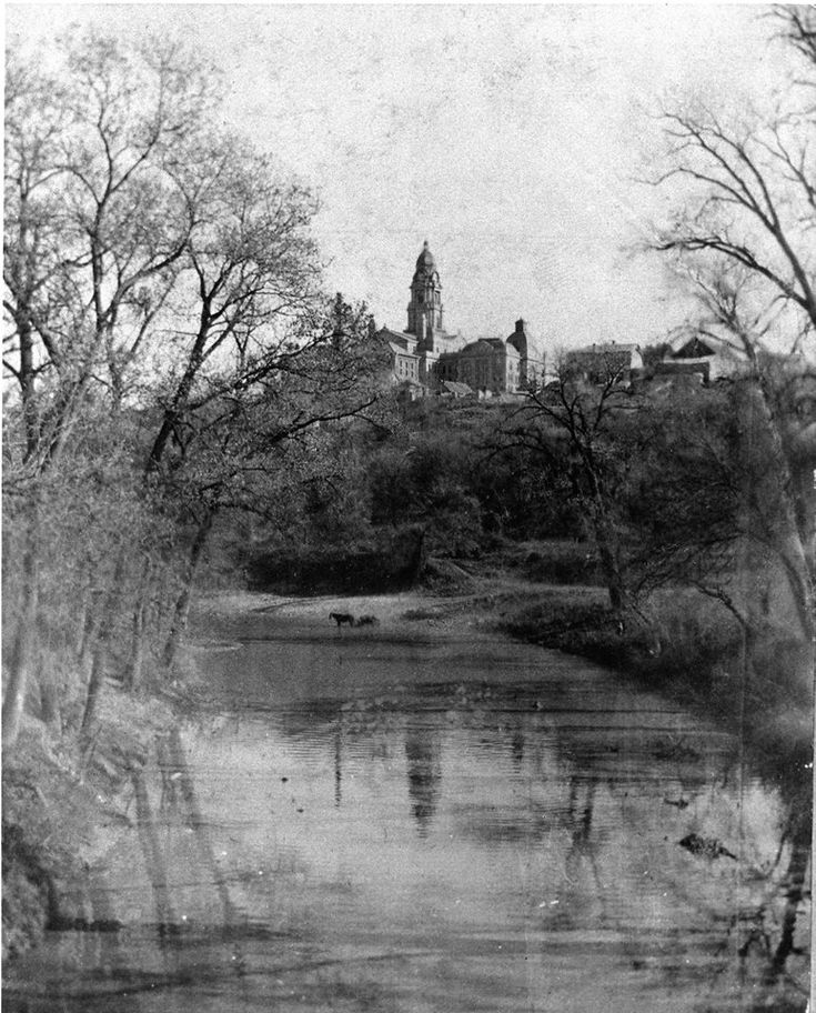 The great folks at UT Arlington's archives tweeted out this AMAZING 1896 photo of the Tarrant County Courthouse in Fort Worth on a bluff as seen from the Trinity River, across which a horse and wagon are crossing. I almost can't believe how great this is. The UTA folks are tweeting up a storm with photos from their incredible collection,