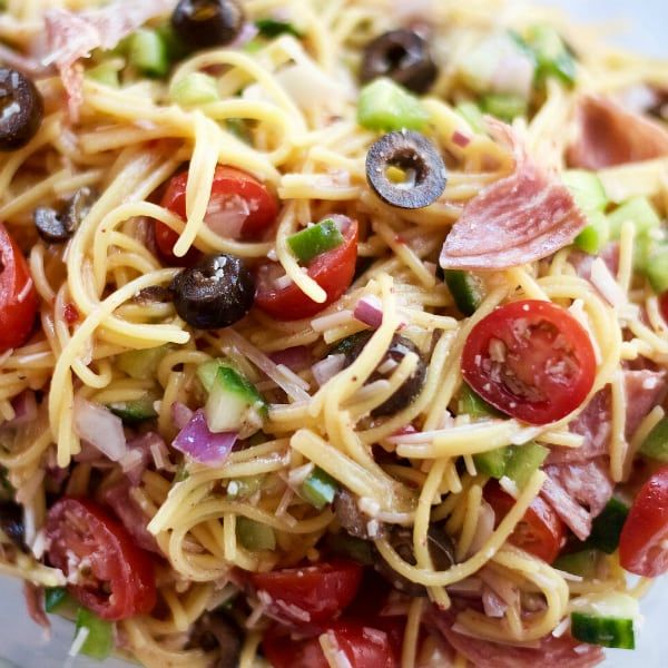 Light and cold, enjoy thisSummer Italian Spaghetti Salad Recipe made with fresh ingredients, and your favorite spaghetti pasta and dressing!