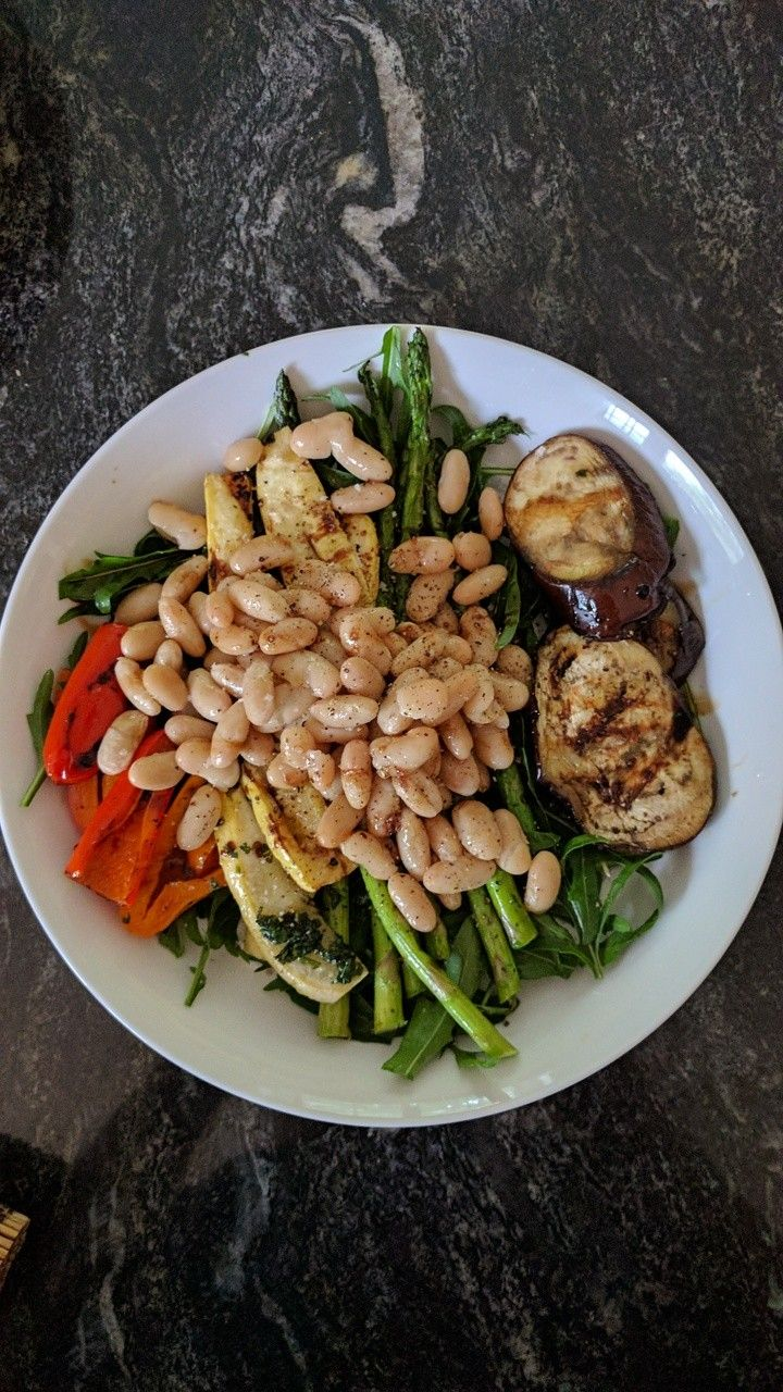 One of my favorite salads.  Grilled asparagus, zucchini, eggplant, red peppers, a bed of wild arugula, cannellini beans drizzled with a little olive oil and lemon.