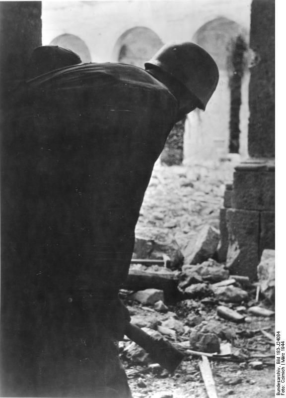 German paratrooper in the ruins of Monte Cassino monastery, Italy, Mar 1944 Photographer   Czirnich Source   German Federal Archive