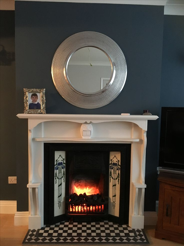 Victorian fireplace with electric inset and Victorian black and white tiled hearth. Wall colour Down the Nile by Valspar paints