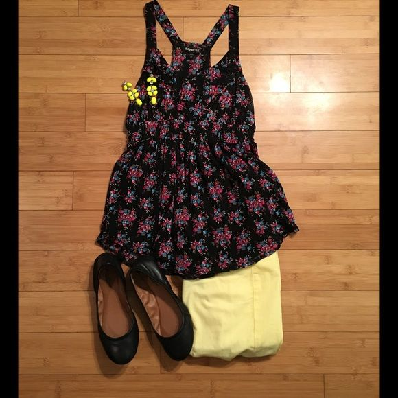 """Express Flower Blouse This top is a flowy racerback tank. It has polyester lining underneath as the body is sheer. It is black and has multicolored flowers on it. It has been worn once and is in great condition. It is approximately 26"""" from shoulder to hem and 14"""" across bust when laid flat. Express Tops Blouses"""