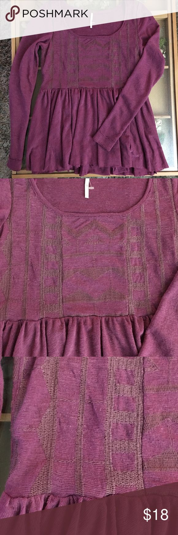 Free People long sleeve Aztec shirt The color is a pink/purple color and the the Aztec stitching is same shade just darker. Raw edging on cuffs and hemline. Free People Tops Blouses