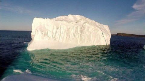 Newfoundland and Labrador, Iceberg, Frozen (Icy), Glacier, Canada, Ice (Nature), Atlantic Ocean, Blue Sky, Coast, Non Urban Scene, Sea (Landscape), North America, No People, Body of Water, Sunshine, Day, Stock Footage,