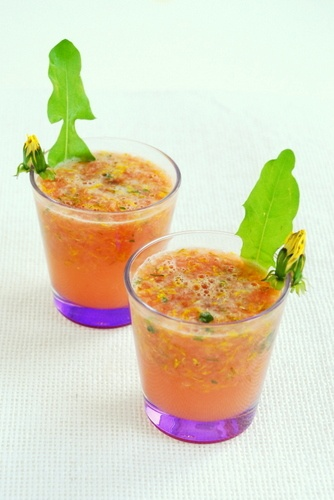 Refreshing cocktail with grapefruit and lemon and various flowers and weeds.