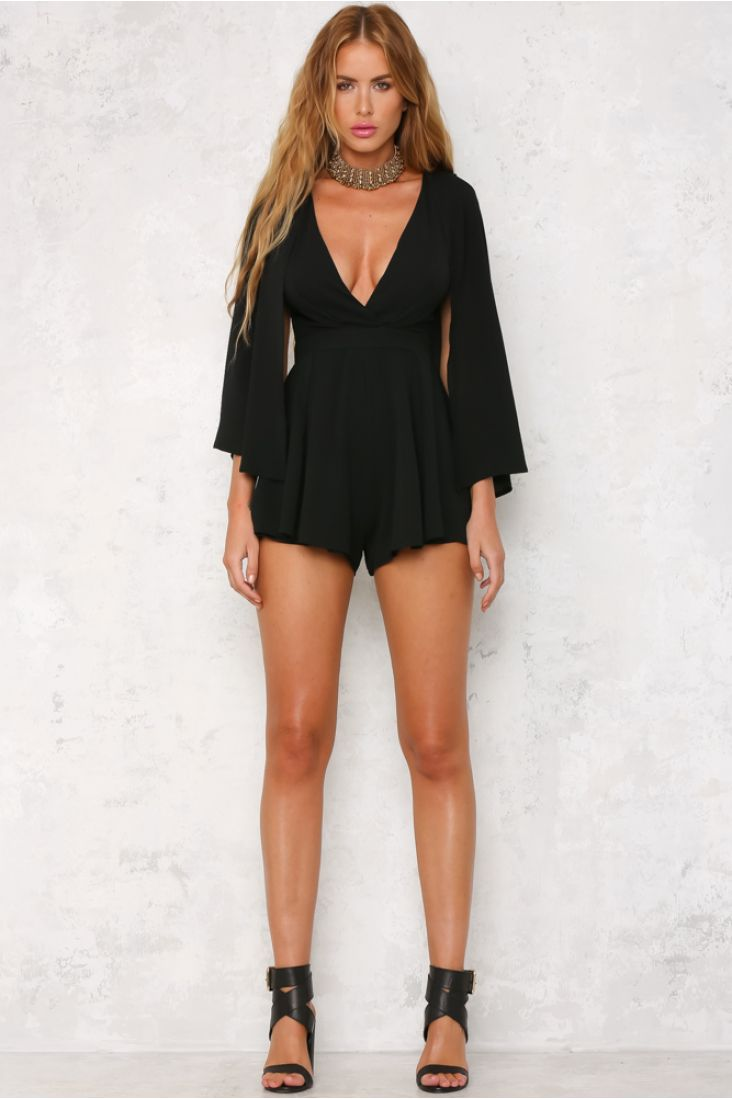 The Blissful Evening Playsuit features an on-trend, cape-style overlaying the sleeveless playsuit. Other details include a deep V neckline, floaty shorts and an invisible zip for easy accessibility. Style yours with black over-the-knee boots for a statement outfit!   Playsuit. Lined. Cold hand wash only. Model is standard XS and is wearing XS. True to size. Non stretchy fabric. Polyester.