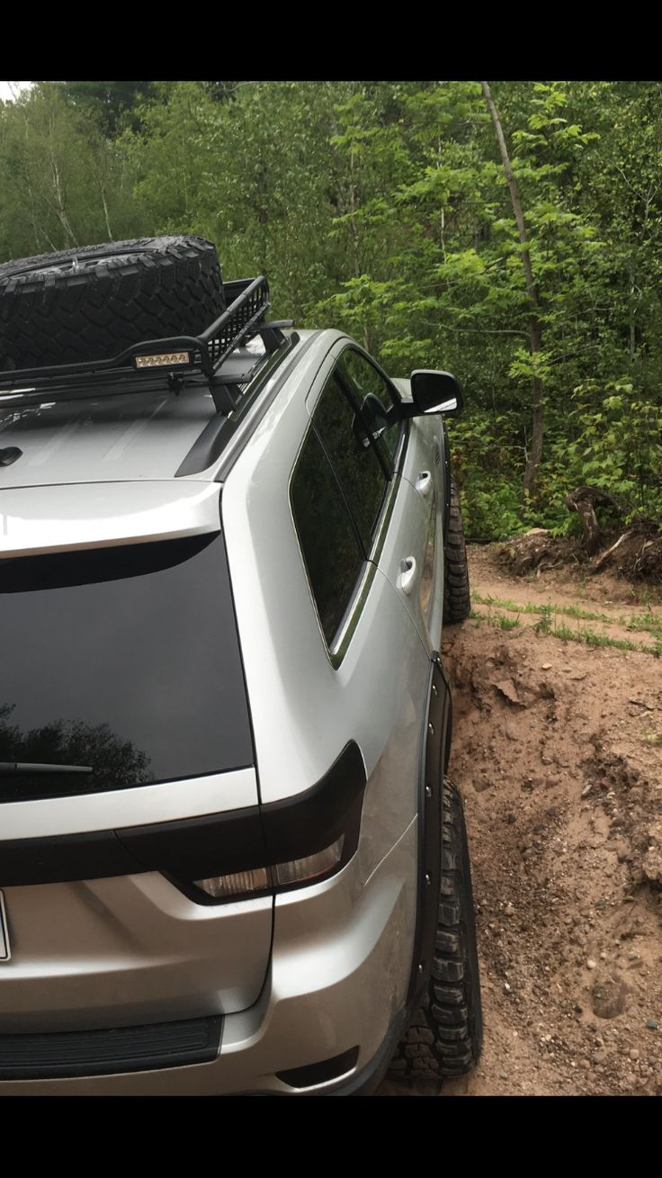 Jeep Grand Cherokee wk2 kumho tires blacked out off road roof rack led lights
