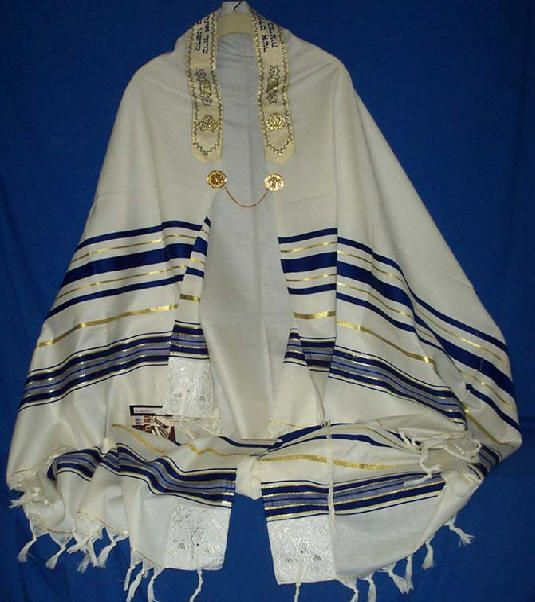 Traditional symbols- The tallit, as shown above, is a Jewish prayer shawl, worn during morning prayers and all prayers on Yom Kippur.