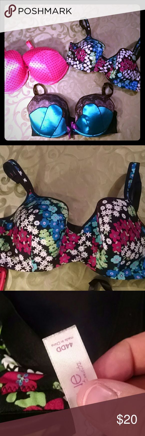 3 Cacique 44DD bras in used condition The coral and the teal are both padded plunge bras. As you can see from last picture the paint is coming off the hooks on the coral, but all hooks and eyes are still in good shape. These bras have never seen the dryer. Teal bra has a little freyed edge on the left strap. Bands on both plunge bras are a little stretched. The last bra is a balconette bra that was only worn a couple times. Cacique Intimates & Sleepwear Bras