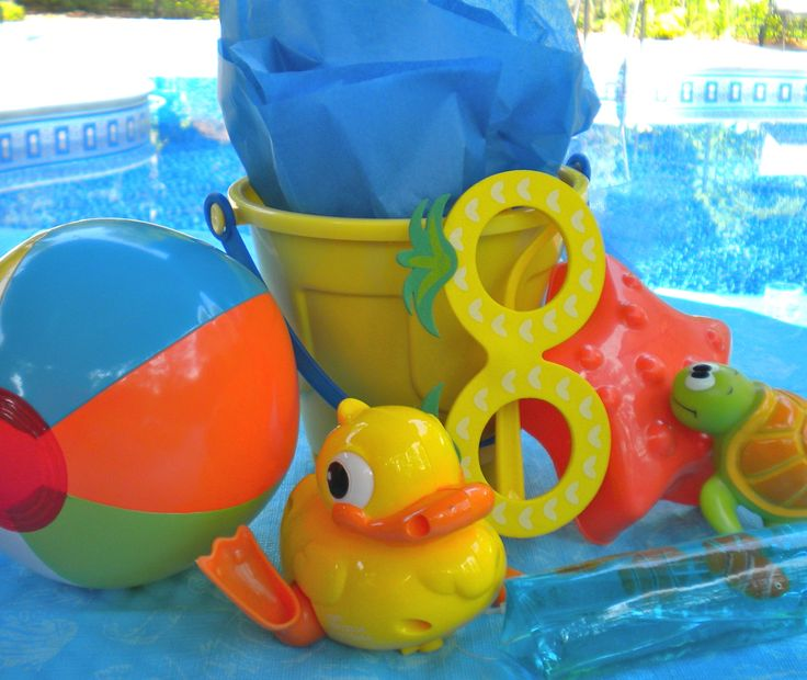 Beach birthday party ideas using beach toys, pails and sand toys.