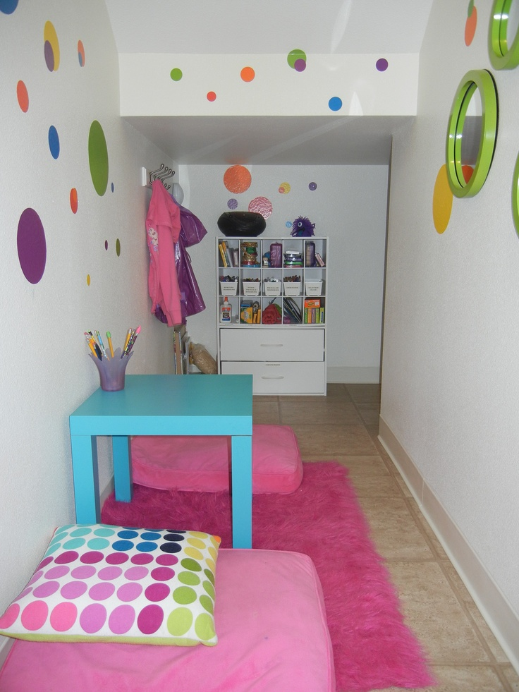 """A """"secret"""" clubhouse in the storage closet under the stairs. This is where they keep all their art supplies, read books and listen to music."""