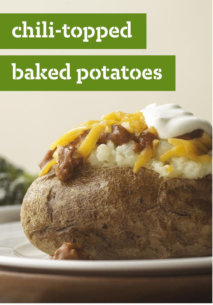 Chili-Topped Baked Potatoes -- Here's a tasty twist on the usual butter, salt and pepper on your baked potatoes. This recipe is topped with a winning trifecta of chili, cheese, and sour cream.